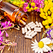 Vitamin bottle among flowers