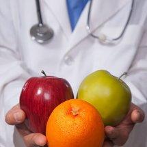 Dr holding fruit
